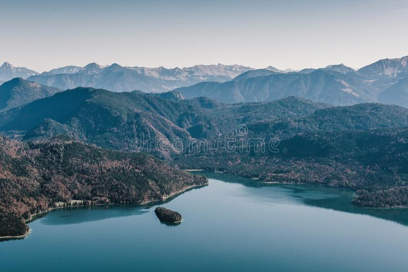 Stillness echoes at Walchensee, Bavaria. Walchensee nestled among the foothills of the alps. Enjoying perfect warm autumn weather making good hiking, day stock photography