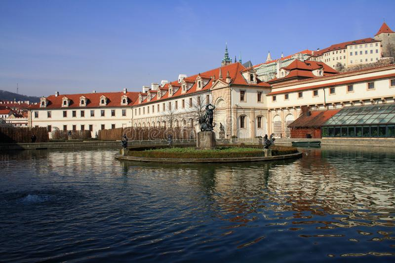Waldstein palace garden and building of the Senate of Czech Republic in Prague. A pond with The Hercules. Waldstein palace garden Valdstejnska Zahrada and royalty free stock images