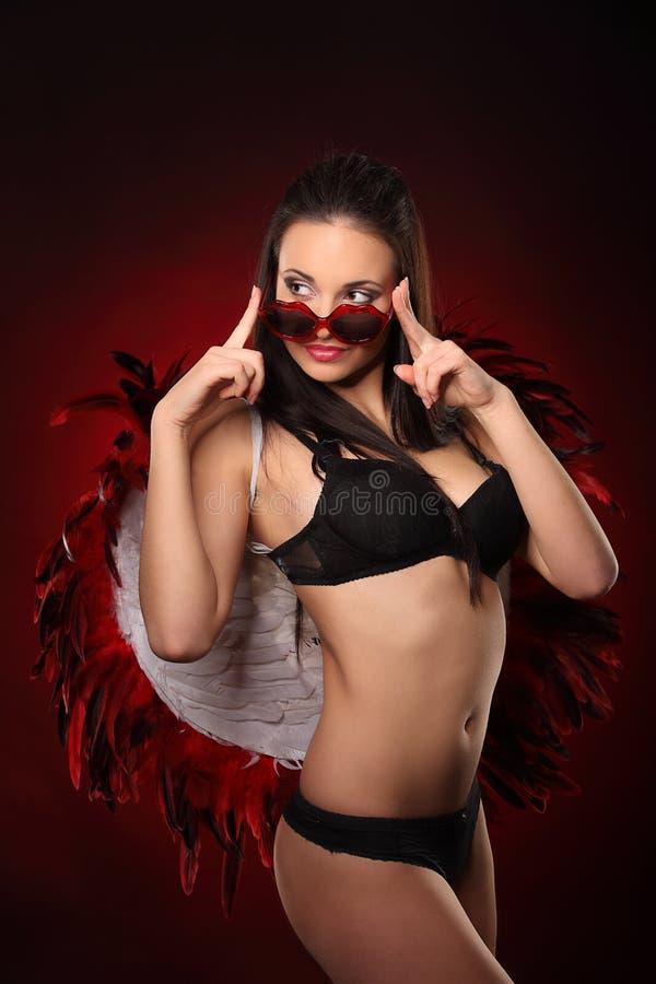 Walentynki piękna dziewczyna z dużym bielem i czerwienią uskrzydla obrazy royalty free