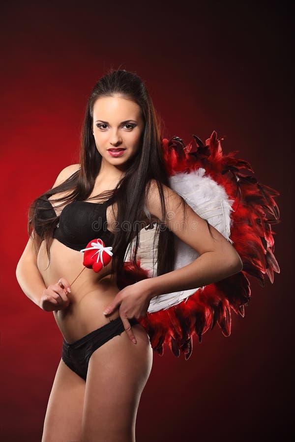Walentynki piękna dziewczyna z dużym bielem i czerwienią uskrzydla zdjęcia stock