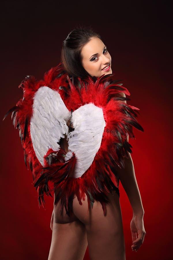 Walentynki piękna dziewczyna z dużym bielem i czerwienią uskrzydla obrazy stock