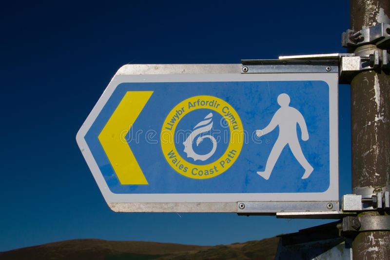 Wales Coastal Path sign. A metal Wales Coastal Path sign mounted on a metal post stock photos