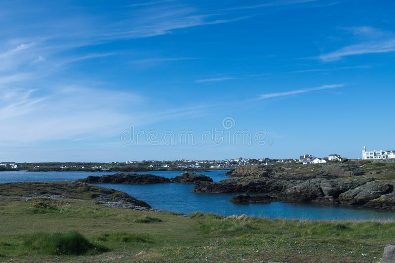 North Wales, the resort of Tearddhur Bay on a sunny spring day. Wales, the resort of Trearddhur Bay on Anglesey on a bright spring day. Small bays and rockpools royalty free stock photos