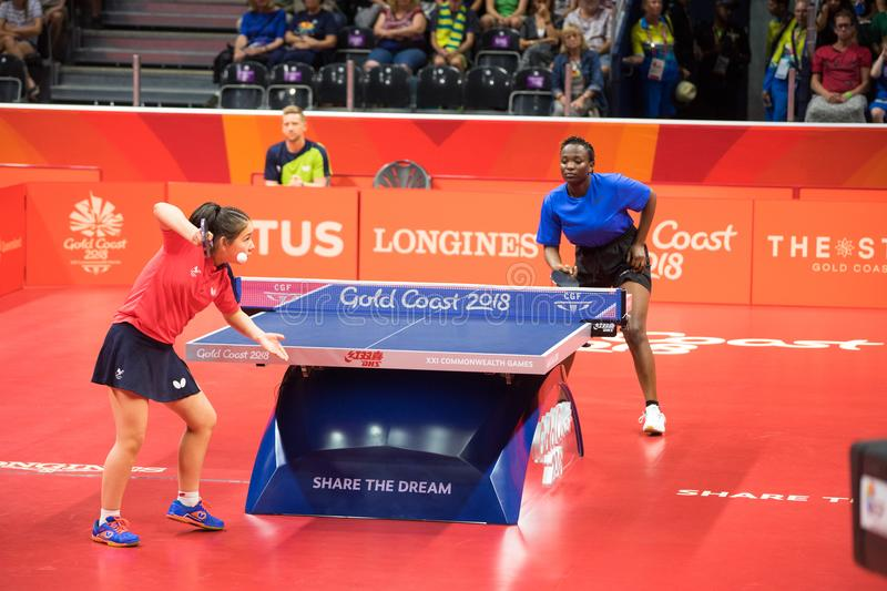 2018 Commonwealth Games Australia Table Tennis. Wales table tennis player Anna Hursey competing with Ugandan player Halima Nambozo during the 2018 Commonwealth royalty free stock photo