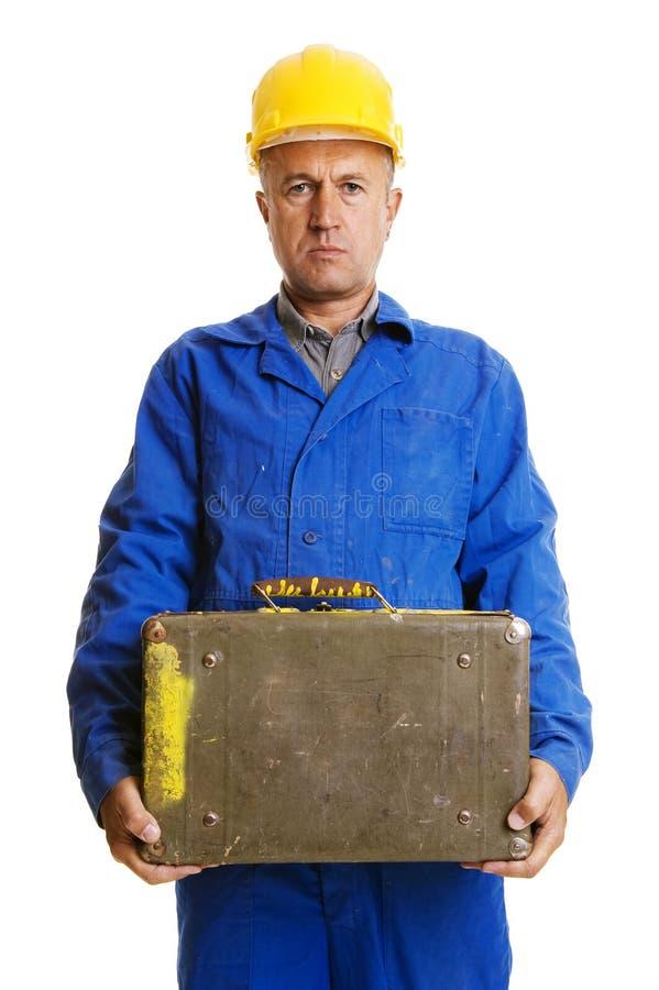 walizka stary poważny pracownik zdjęcia royalty free