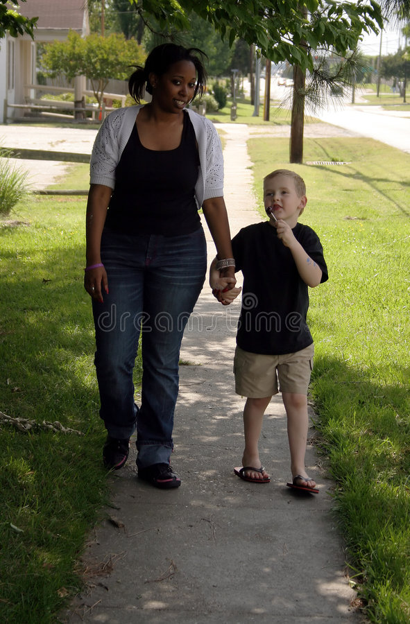 Walk. A child and babysitter on a walk royalty free stock image