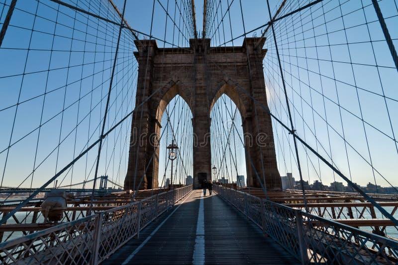 Walk across Brooklyn Bridge backlit stock image