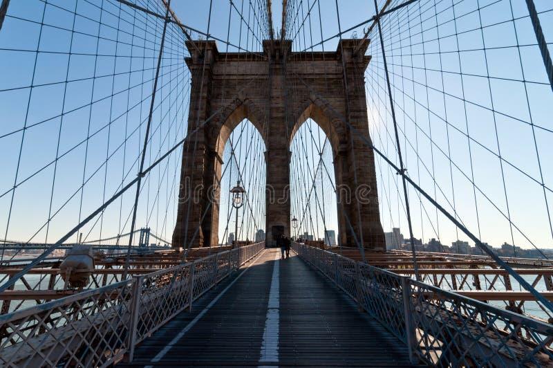 Walk across Brooklyn Bridge backlit royalty free stock photos