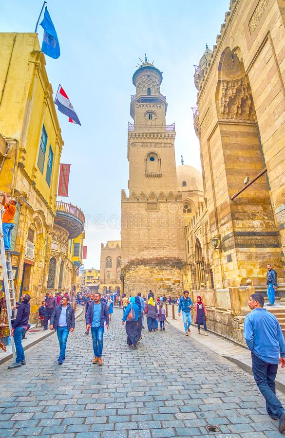 Walk along medieval neighborhood in old Cairo, Egypt. CAIRO, EGYPT - DECEMBER 20, 2017: Edifices along Al-Muizz street are the masterpieces of medieval Egyptian royalty free stock images