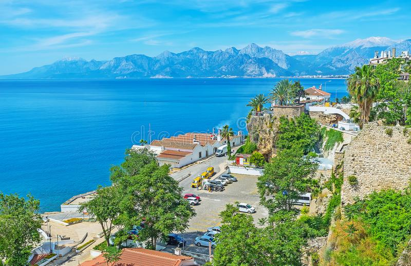 The coast of old Antalya. The walk along the medieval ramparts of Antalya with a view on its beautiful coast with Taurus mountains on background, Turkey stock photos