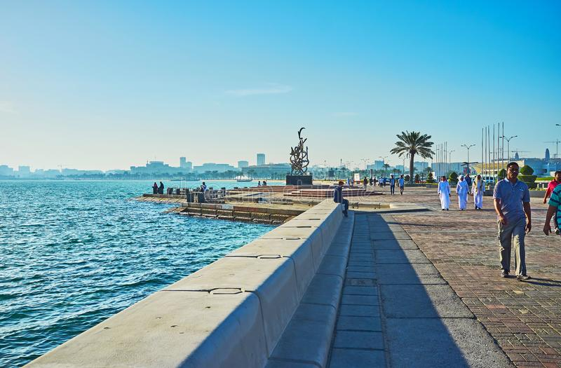 Walk along the sea in Doha, Qatar. DOHA, QATAR - FEBRUARY 13, 2018: The walk along the sea with a view on Calligraphy sculpture of Sabah Arbilli on the royalty free stock photos