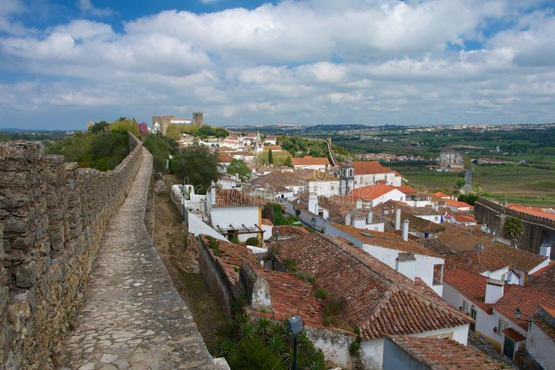 Walk on a ancient wall of the fortress of Obidos royalty free stock photo
