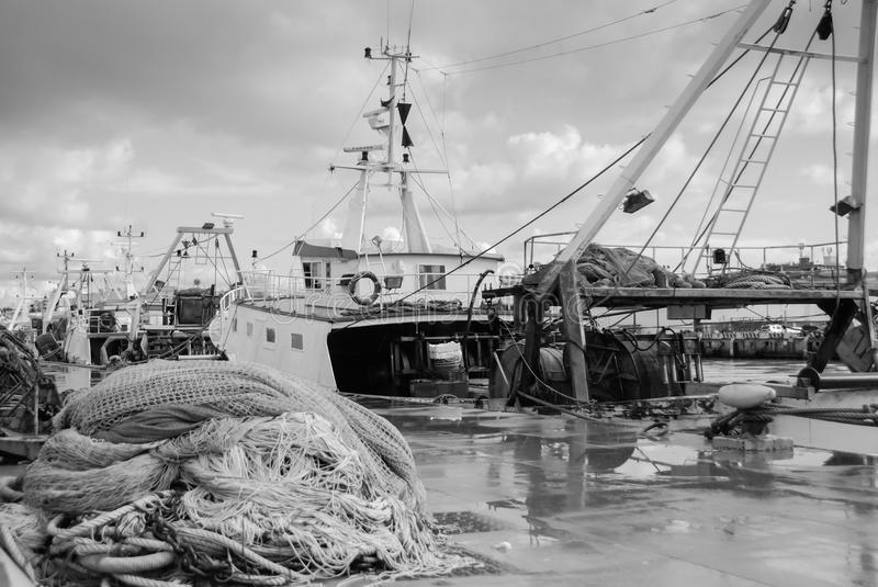 Walk around the dock between the fishing nets stock images