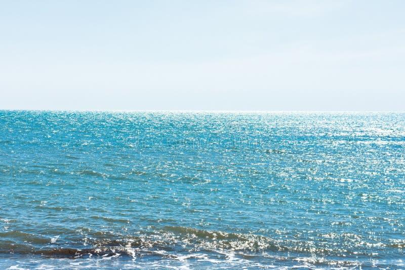 A walk at the beach on a sunny day stock photos