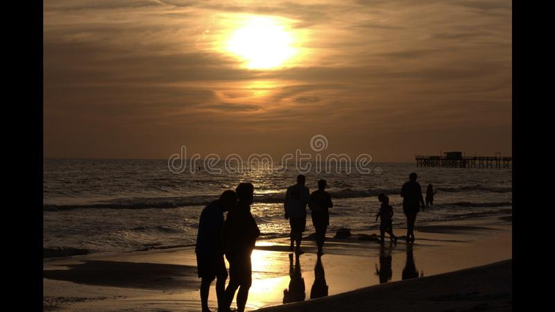 A walk on the beach at sunset stock photography