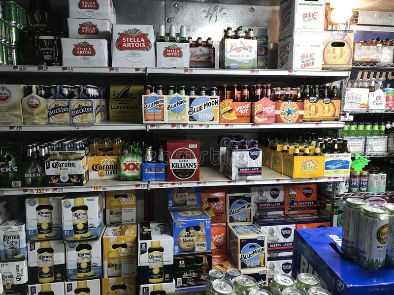 Walk in beer cave. A walk in cooler filled with assorted beer and other alcoholic beverages for sale in a grocery store stock photography