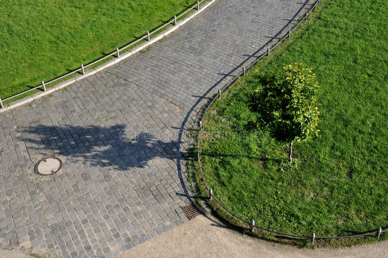 Walk in city park, dresden. Aerial view of paving on walk in green city park stock images