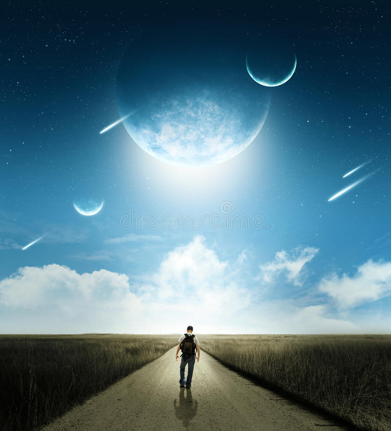 Walk with comets. Walking man with brilliant comets and moons in space