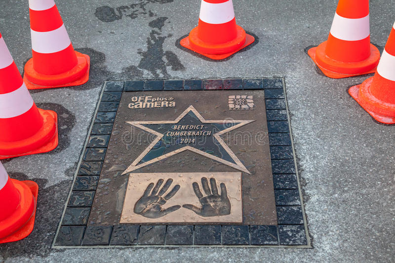 Walk of fame with Benedict Cumberbatch plate. Off plus camera walk of fame with Benedict Cumberbatch handprint plate in Krakow royalty free stock photography