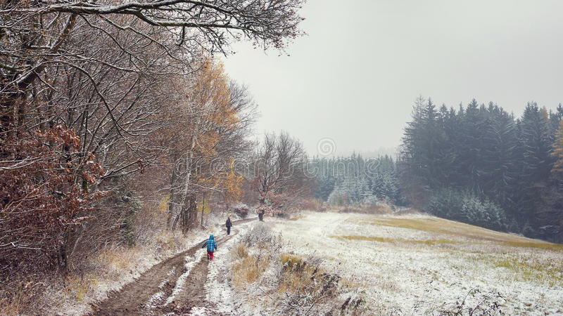 Walk in first snow in winter countryside royalty free stock photography