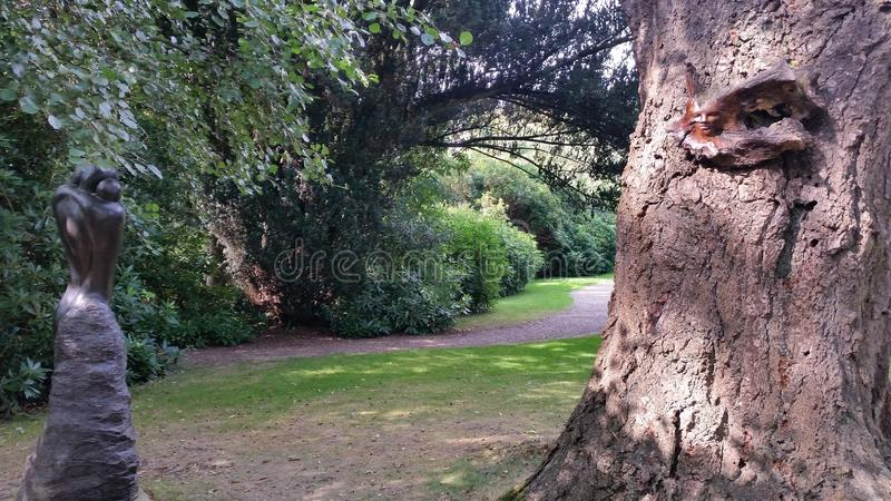 Walk in the gardens with hives stock photography