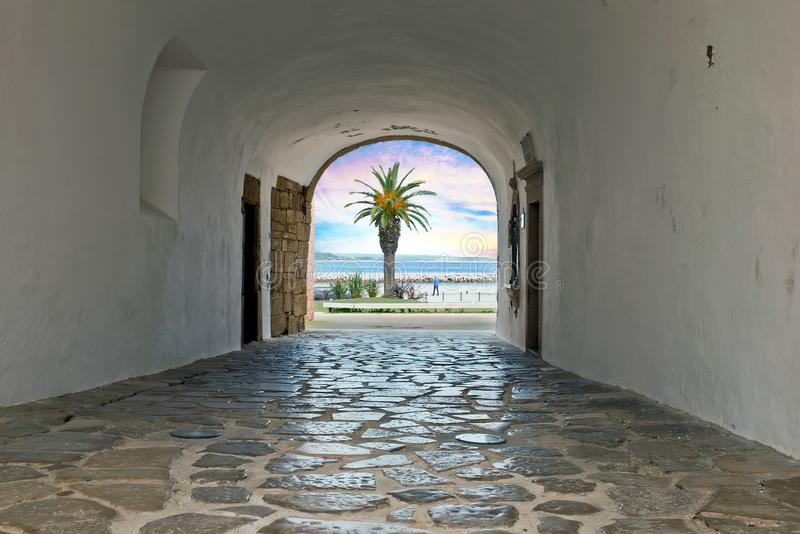 Walk through a medieval entrance to the ocean in Lagos Portugal stock image