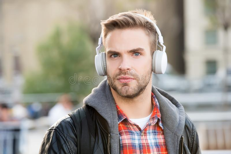 While walk. Online education courses. Listen music. Ebook audio concept. Student study use headphones. Handsome man royalty free stock photography