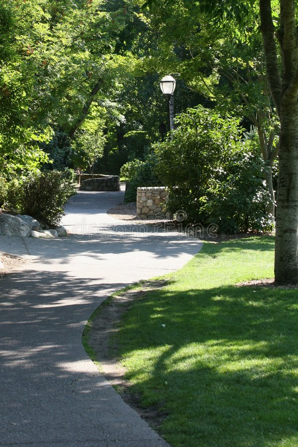 A walk in the park. A pathway leading through an Oregon city park stock photo