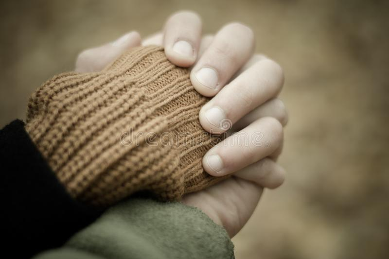 The girl holds the man by the hand. Walk through the park. The girl holds the man by the hand royalty free stock photo