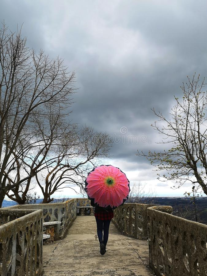 Walk in the rain with an umbrella. Walk in the rain royalty free stock images