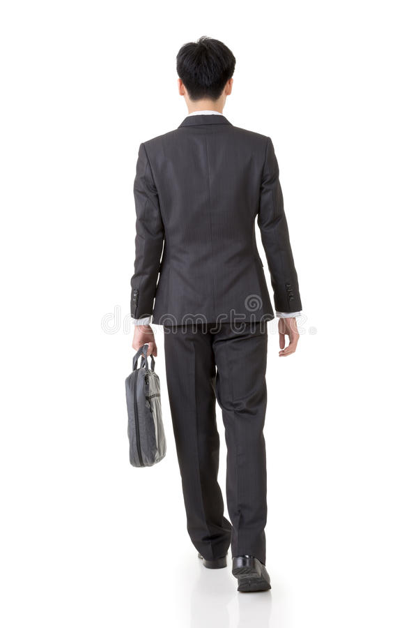 Walk, rear view. Rear view of Asian business man walk, full length portrait isolated on white background royalty free stock images