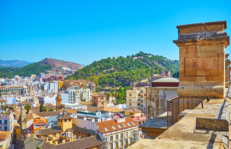 On roof of Malaga Cathedral, Spain. Walk the roof of Malaga Cathedral and observe old town with green city hill, topped by Gibralfaro castle, Spain royalty free stock images