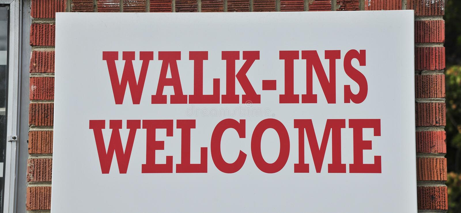 Walk In`s Welcome. A walk in`s welcome sign on a building that serves customers and clients without an appointment stock images