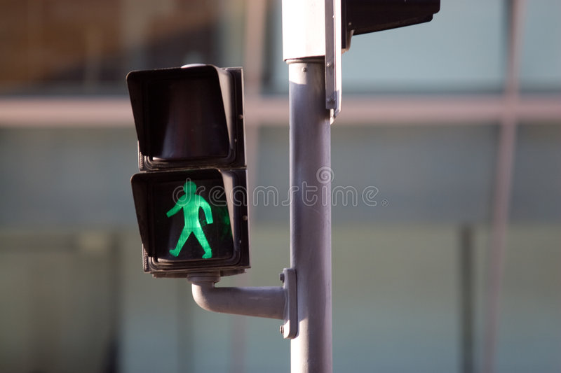 Walk sign. Walk traffic sign in a residential neighborhood of Barcelona stock image