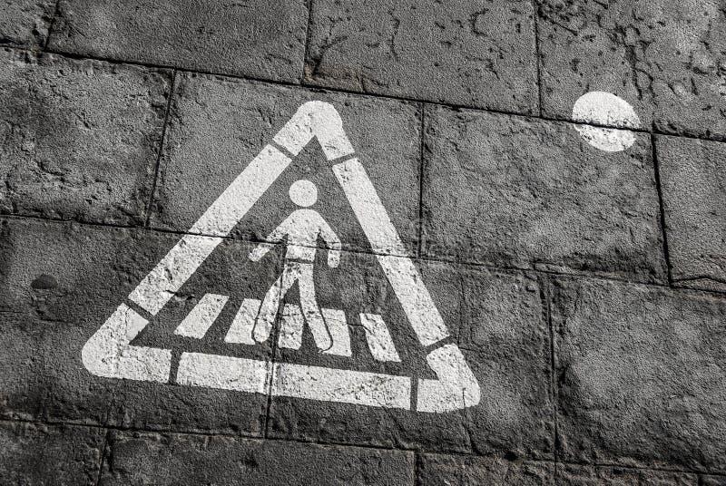 Walk Sign on ground. Walk sign, pedestrian street sign on a wet dark tile floor stock photos