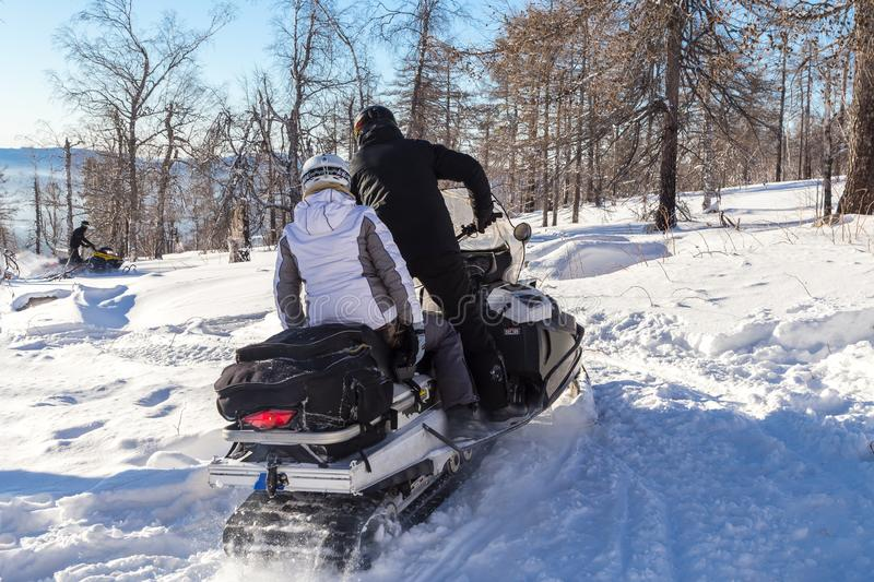 Athletes on a snowmobile. stock image
