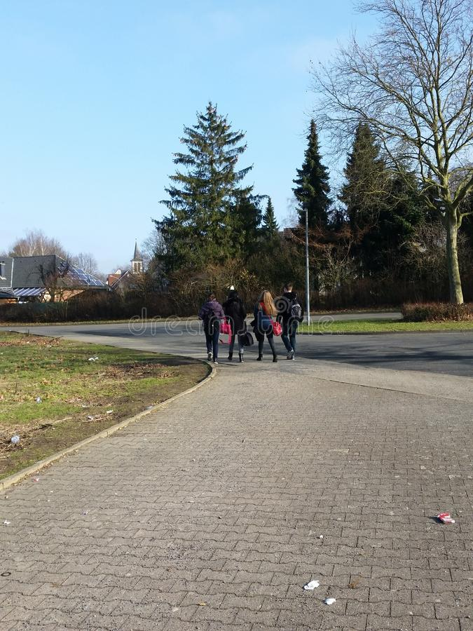 Walk on a street. Four people walk on a street in germany stock images