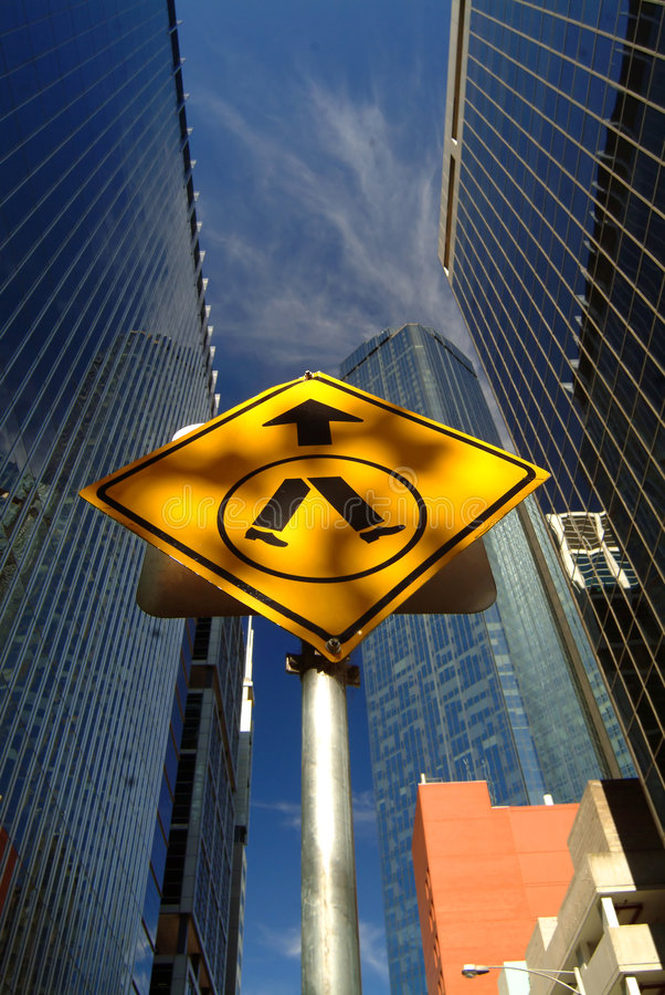 Walk street sign. In middle of road, Melbourne, Australia royalty free stock image