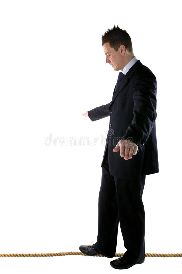 Walk the tightrope royalty free stock photo