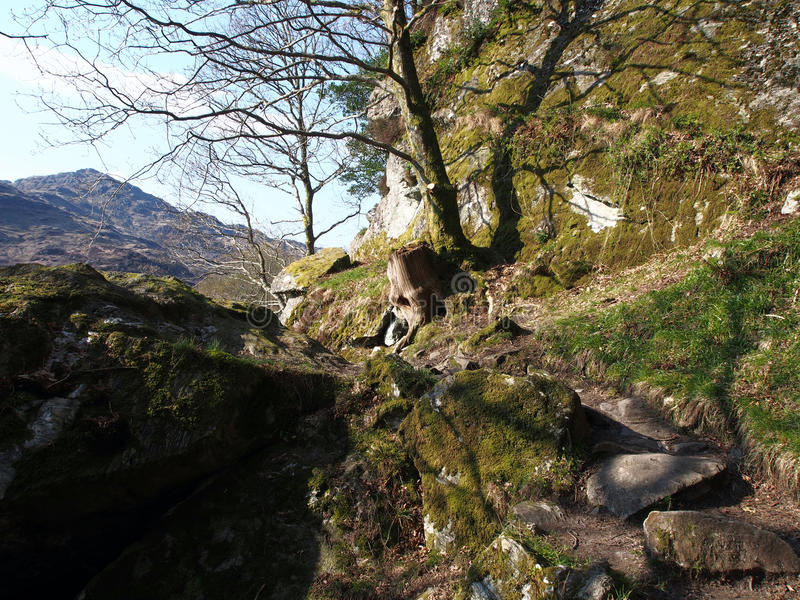 Walk to Rob Roy's Cave, Loch Lomond. Rob Roy's cave lies just North of Inversnaid on the banks of Loch Lomond. Legend has it Rob Roy used the cave as a hide-out royalty free stock image