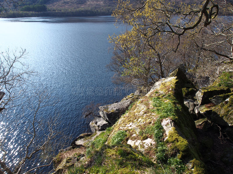 Walk to Rob Roy's Cave, Loch Lomond. Rob Roy's cave lies just North of Inversnaid on the banks of Loch Lomond. Legend has it Rob Roy used the cave as a hide-out stock photo
