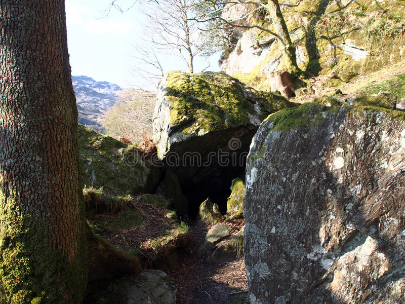 Walk to Rob Roy's Cave. Take a journey back to Rob Roy Country. The small pier at Inversnaid is situated on the east shore of Loch Lomond stock images