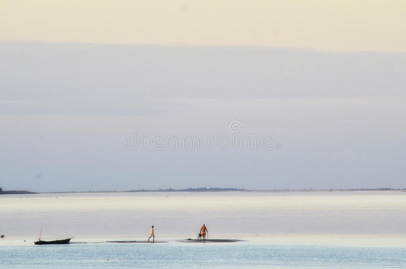 Walk on the Water. Sunset at Nimati Ghat, Jorhat, Assam, India royalty free stock images