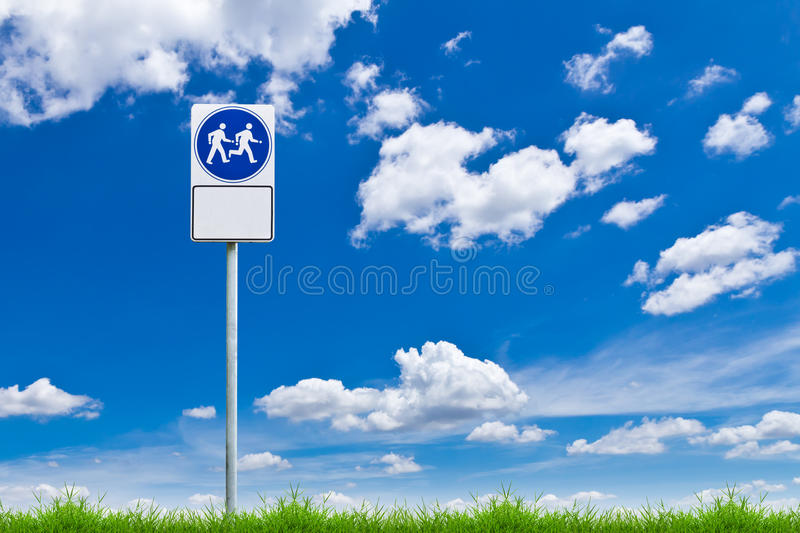 Walk way sign against blue sky. And green grass stock photography