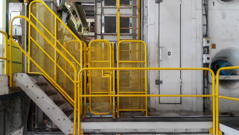 Walk way with yellow handrail inside factory royalty free stock photos