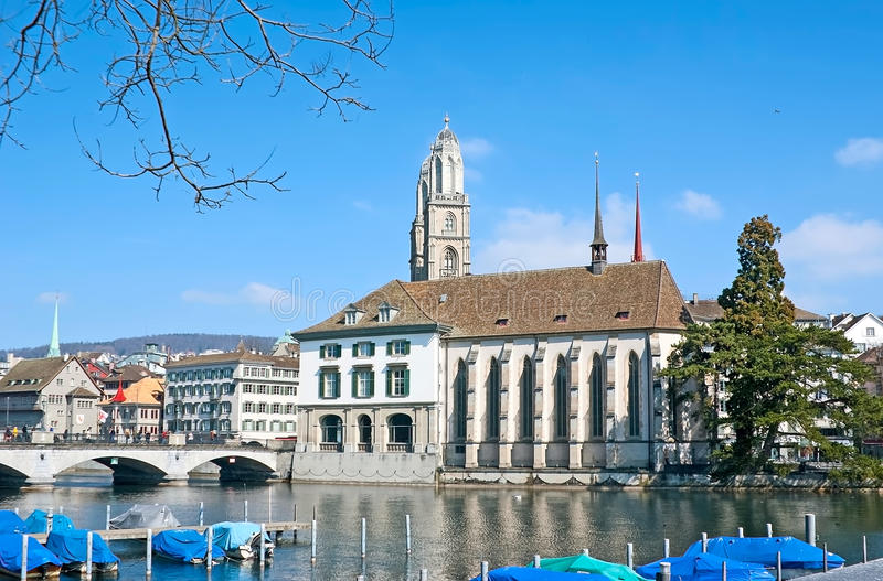 The walk in Zurich. The Limmatquai embankment with the view on Wasserkirche church, belfries of Grossmunster and the Helmhaus, Zurich, Switzerland royalty free stock photography