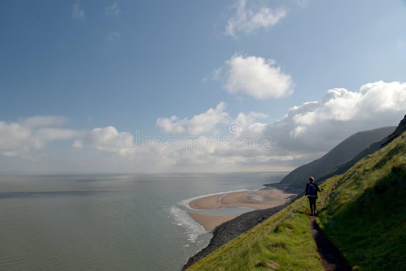 Walker on coastal path near Bossington royalty free stock photography