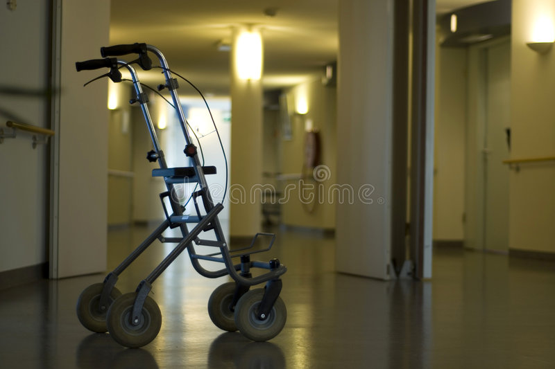 Walker in hall hospital. Walker ready for use in the hall of a hospital royalty free stock photography