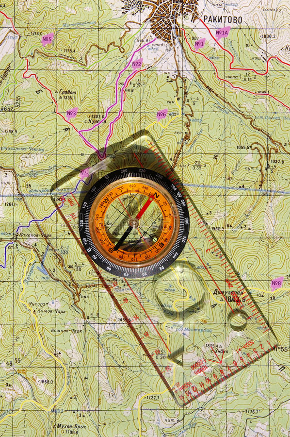 Walkers compass and on a topo map. Walkers liquid-filled compass and on a topo map stock image