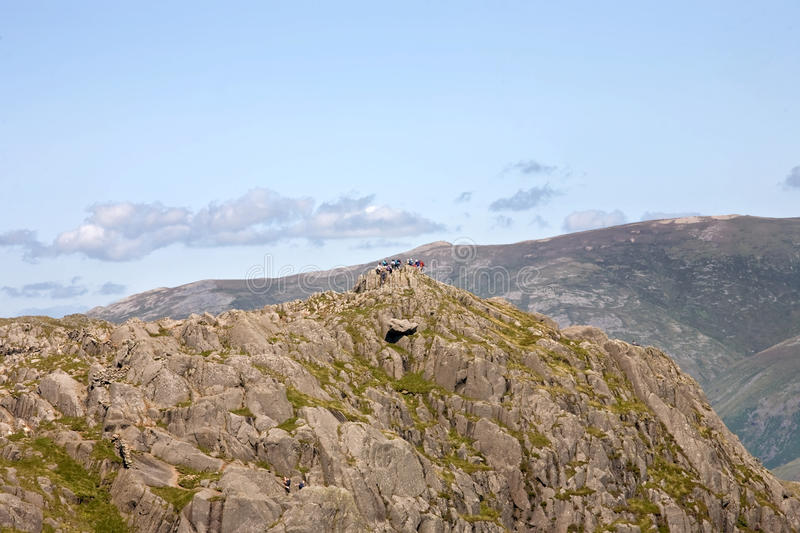 Walkers on Pavey Ark stock photography